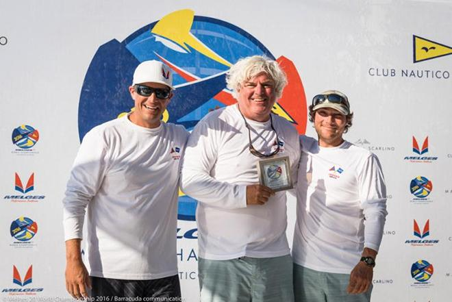 Rob Wilber (center) and his Cinghiale team featuring Sam Rogers (left) and Ben Allen (right) happily accept their daily award for winning Race Five. © Barracuda Communications