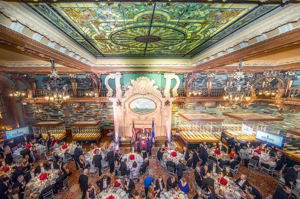 """The America's Cup Hall of Fame induction was held at the New York Yacht Club's magnificent Model Room. Measuring forty-five feet wide and ninety-six feet deep, the Model Room holds most of the Club's collection of approximately 1,300 models—including fully-rigged models of Cup challengers and defenders. The galleon-style bay windows and the carvings of dolphins, shells, and clouds punctuated with lightning bolts, create the impression, as one visitor observed, that """"except for the absence of motion, one might fancy oneself at sea."""" - Hall of Fame induction for Ernesto Bertarelli Alinghi and Lord Dunraven - photo © Carlo Borlenghi http://www.carloborlenghi.com"""