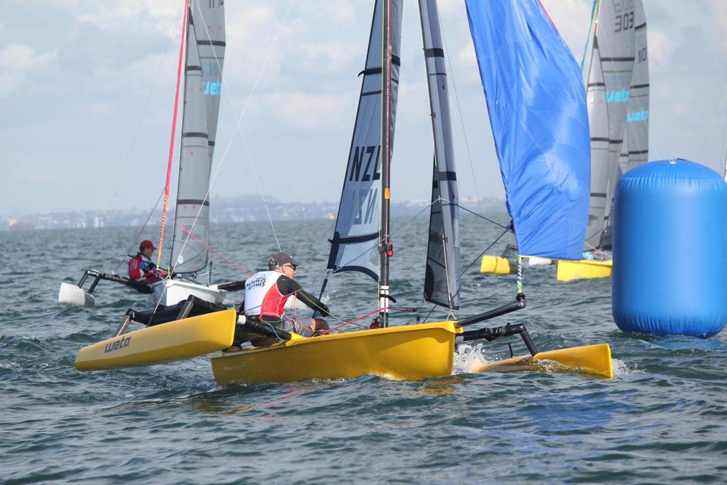 Predictwind's Jon Bilger sailing on Day 4 of the World Masters Games in the single handed Weta division - photo © Yachting New Zealand