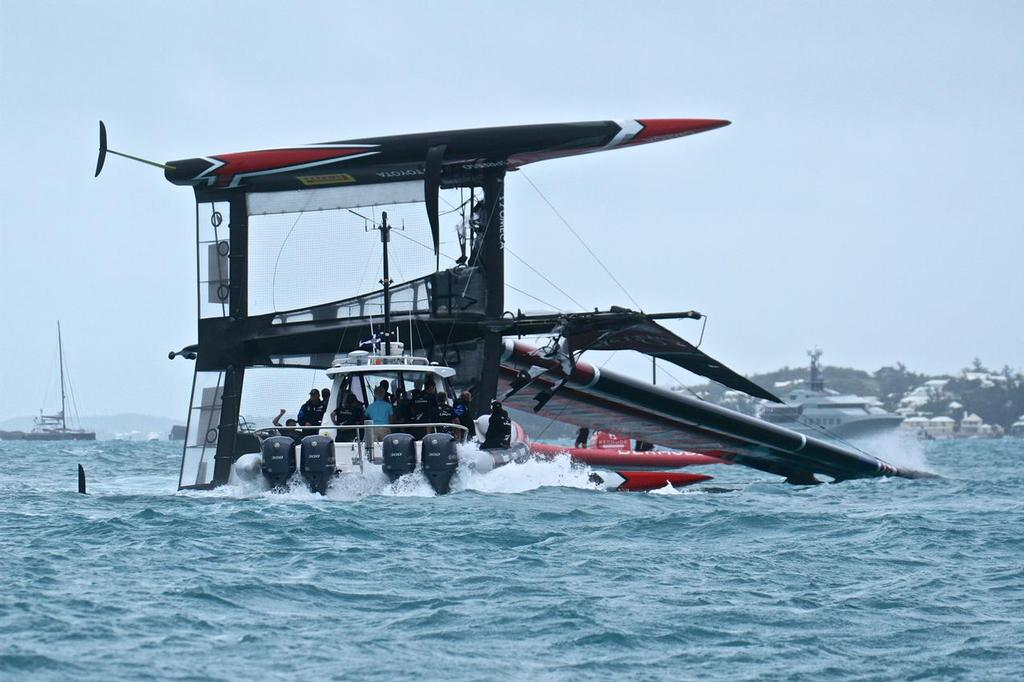 Emirates Team New Zealand is manoeuvred into a position where  she can be righted - Semi-Final, Day 11 - 35th America's Cup - Bermuda  June 6, 2017 © Richard Gladwell www.photosport.co.nz