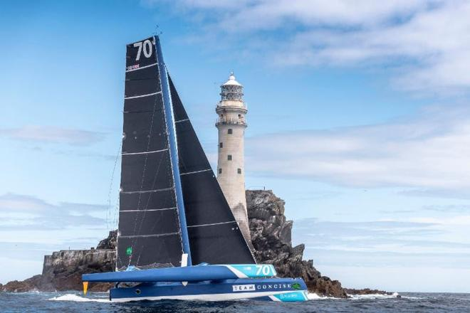First around the Fastnet Rock and Multihull Line Honours for Tony Lawson's MOD70 Concise 10 ©  Rolex/ Kurt Arrigo http://www.regattanews.com