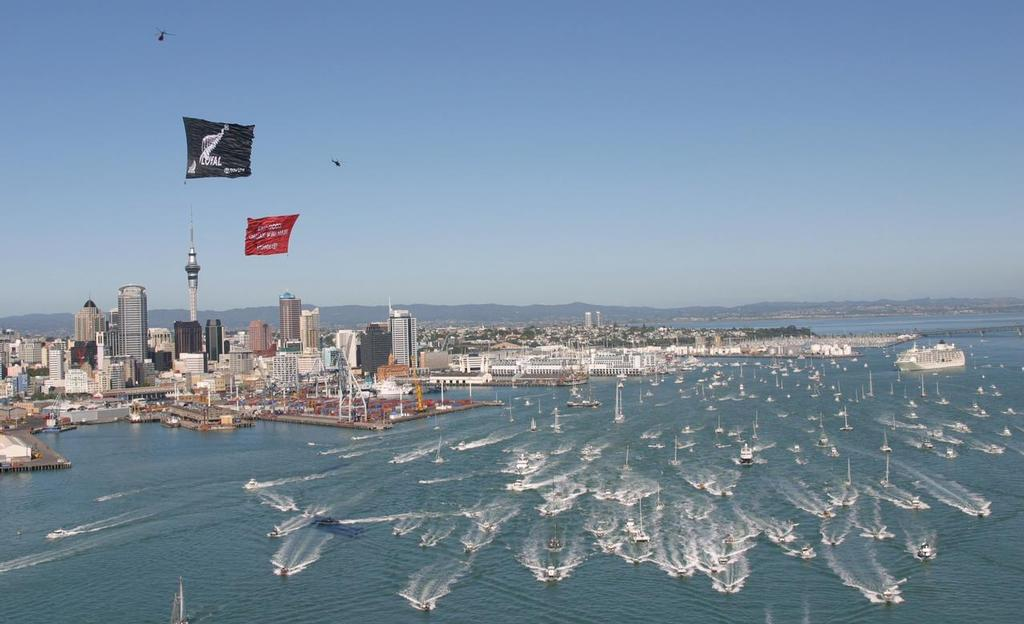 Team New Zealand leads a fleet of support boats out to the Hauraki Gulf from downtown Auckland. 2003 America's Cup © Kaoru Soehata