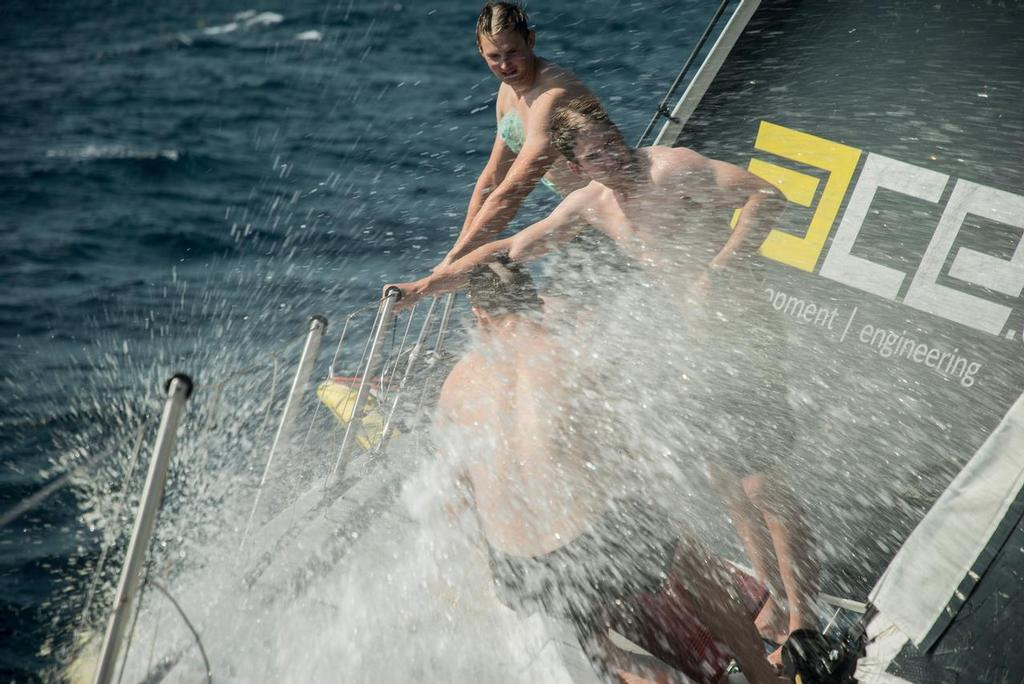 Leg 2, Day 9 on board Brunel. Lisbon to Cape Town, The america's cup guys take a shower on the bow, Volvo Ocean Race. 13 November, 2017 ©  Rich Edwards / Volvo Ocean Race