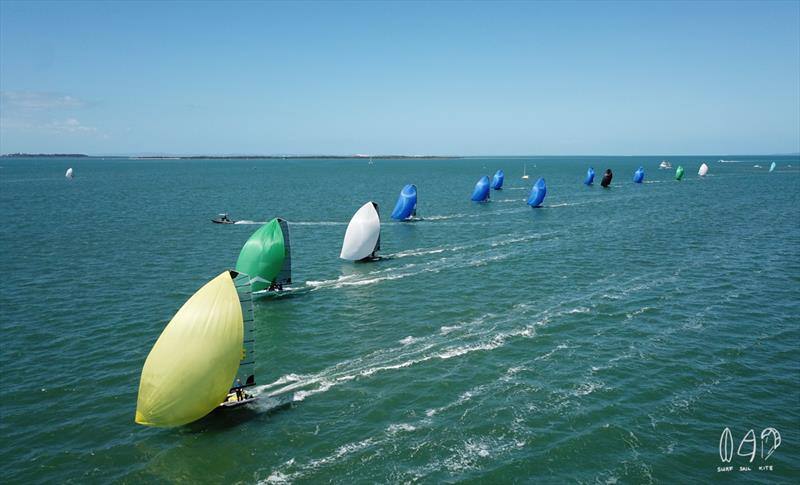 A colourful site as the 16's fly downwind - photo © Mitchell Pearson / SurfSailKite