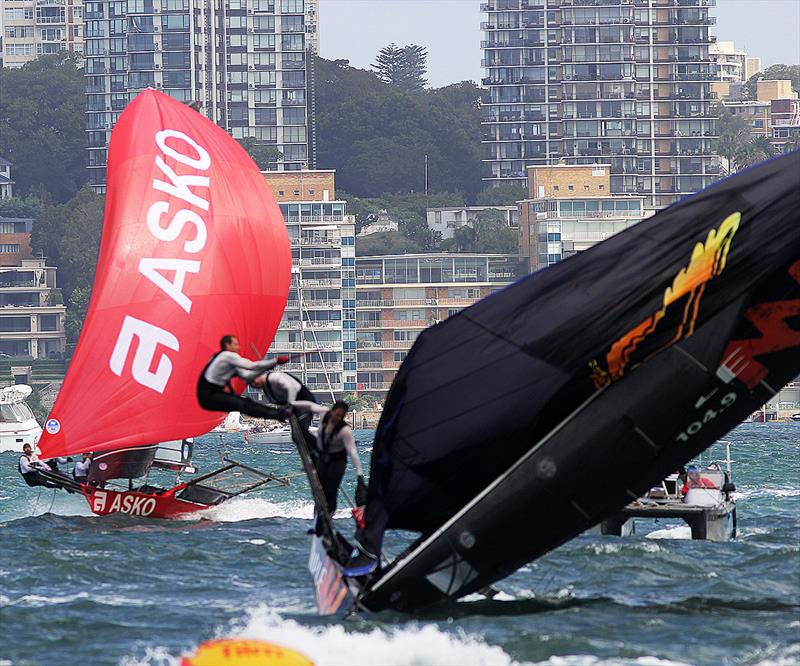 Triple M capsizes as Asko Appliances roars home under spinnaker on day 3 of the 18ft Skiff Australian Championship 2018 - photo © Frank Quealey