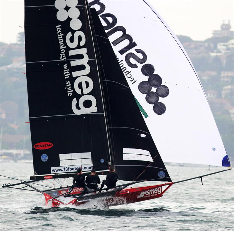 Smeg's spinnaker run down the harbour on lap two was spectacular in race 4 of the 18ft Skiff Spring Championship on Sydney Harbour photo copyright Frank Quealey taken at Australian 18 Footers League and featuring the 18ft Skiff class