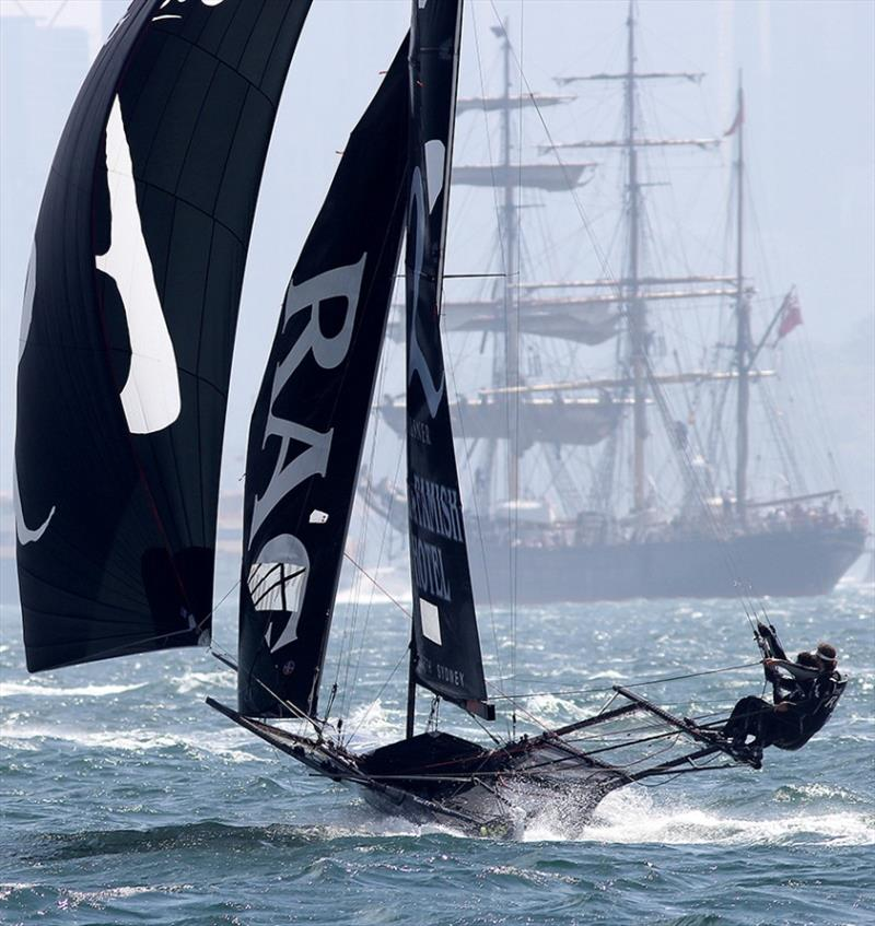 A contrast of old and new on Sydney Harbour as The Rag powers downwind - photo © Frank Quealey