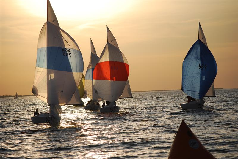 Sonars carrying kites in the setting sun - photo © Image courtesy of Rochester Yacht Club