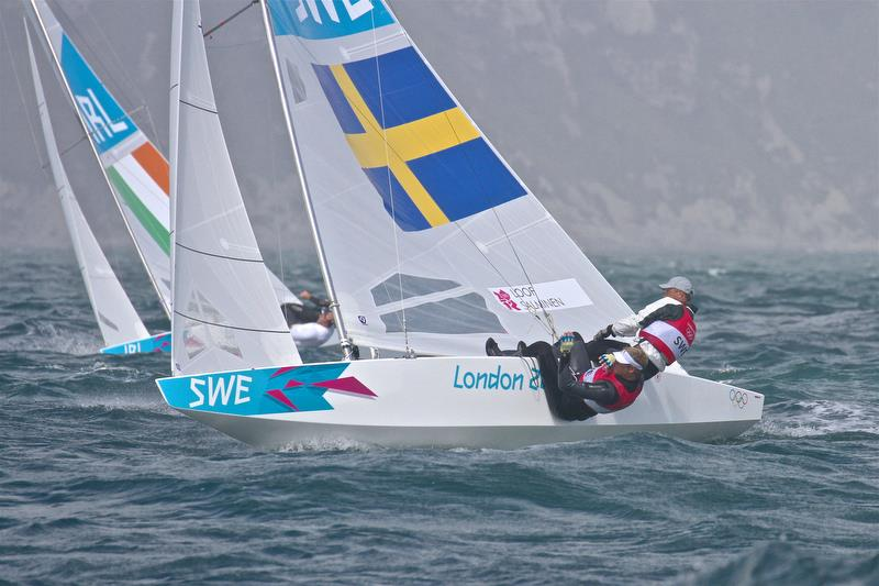 Freddie Loof and Max Salminen (SWE) on their way to winning the Star class Gold medal the 2012 Olympics. Loof a winner of three Olympic medals placed second in the 2019 Symonite OK Worlds - photo © Richard Gladwell