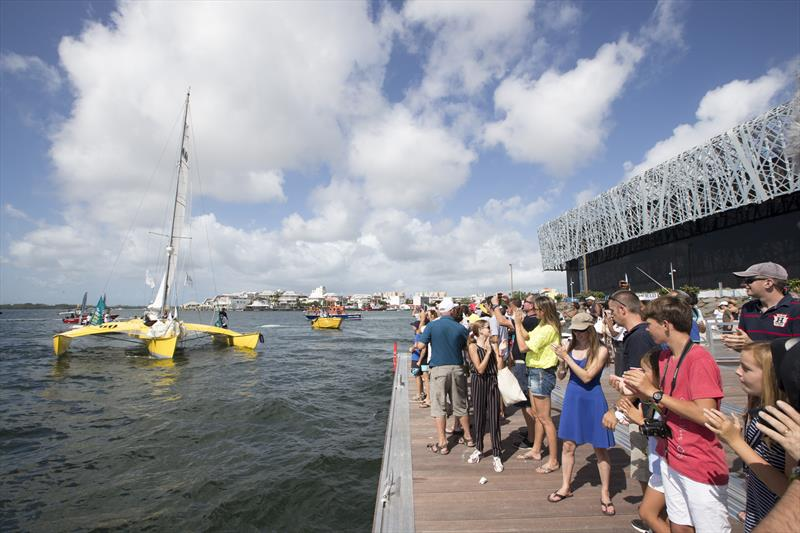 Crowds lined the pontoons and breakwaters at Pointe-à-Pitre's Memorial ACTe to greet Loïck Peyron and Happy after finishing the Route du Rhum-Destination Guadeloupe photo copyright Alexis Courcoux taken at  and featuring the Trimaran class