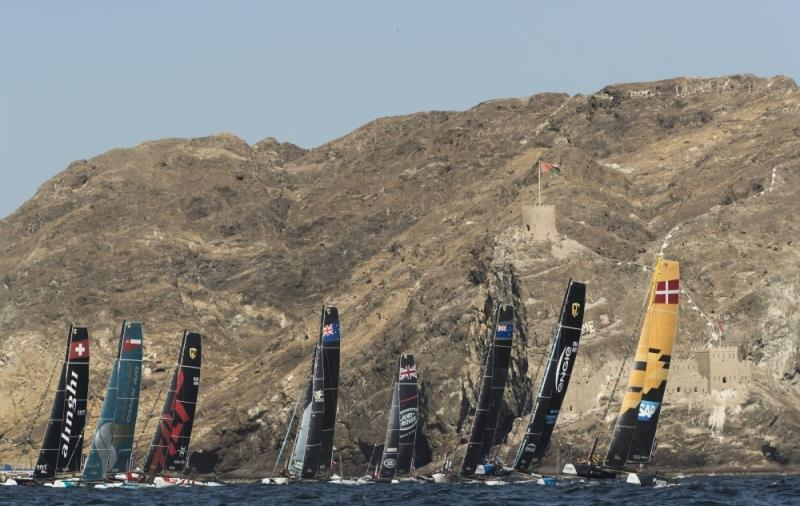 Extreme Sailing Series 2017. Muscat. Oman. The fleet racing close to the shore and historic town of Mutrah - photo © Lloyd Images