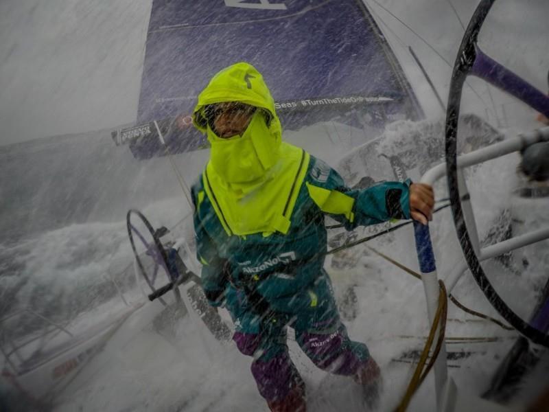 Martine Grael (BRA) turns her back on the stinging sea spray during team AkzoNobel's record setting 24-hour run on Leg 9 of the Volvo Ocean Race - photo © Konrad Frost / Volvo Ocean Race