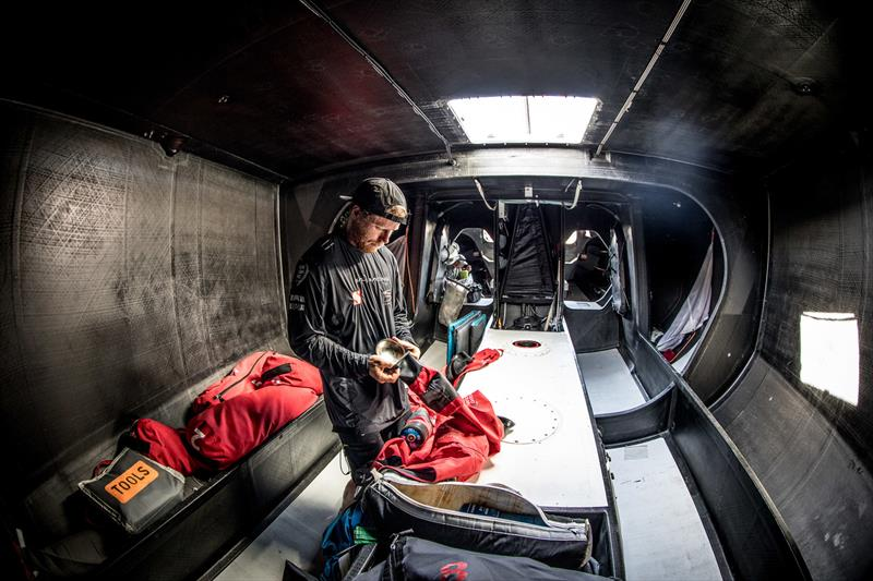 Leg 4, Melbourne to Hong Kong, day 11 Luke Parkinson repairing a seal on his jacket. Not needed now but the forecast has much wetter conditions in the coming week on board Sun Hung Kai / Scallywag. - photo © Konrad Frost / Volvo Ocean Race