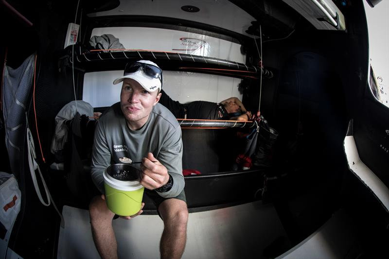 Leg 4, Melbourne to Hong Kong, day 11 Trystan Seal having breakfast on board Sun Hung Kai / Scallywag. - photo © Konrad Frost / Volvo Ocean Race