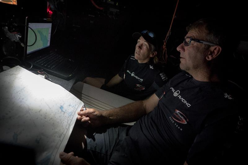 Leg 4, Melbourne to Hong Kong, day 5 Libby Greenhalgh and David Witt checking the navigation on board Sun Hung Kai / Scallywag. - photo © Konrad Frost / Volvo Ocean Race