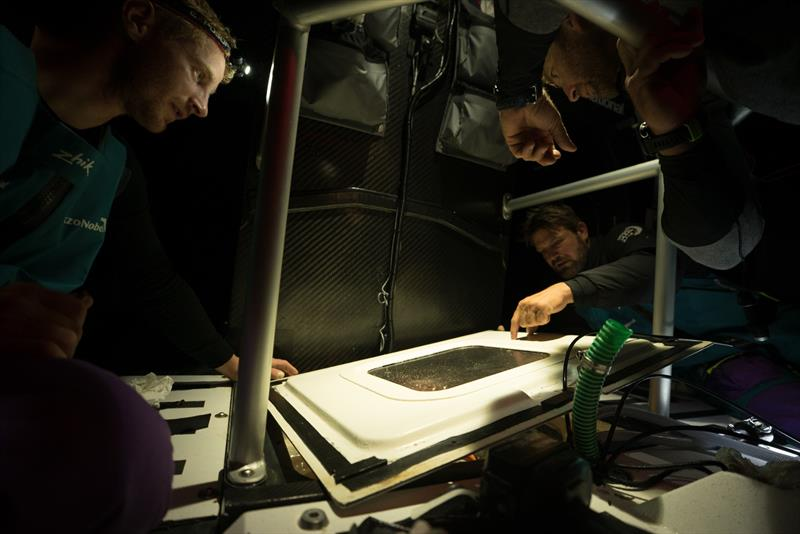 Leg 7 from Auckland to Itajai, day 16 on board AkzoNobel. 01 April, . Nicolai Sehested, Simeon Tienpoint and Jules Salter inspect the keel wetbox lid. - photo © James Blake / Volvo Ocean Race