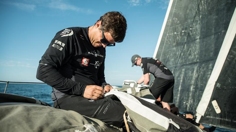 Volvo Ocean Race Leg 8 Itajai To Newport, Fontes fixing a bag on the foredeck, Day 1 on board Sun Hung Kai / Scallywag. - photo © Rich Edwards / Volvo Ocean Race