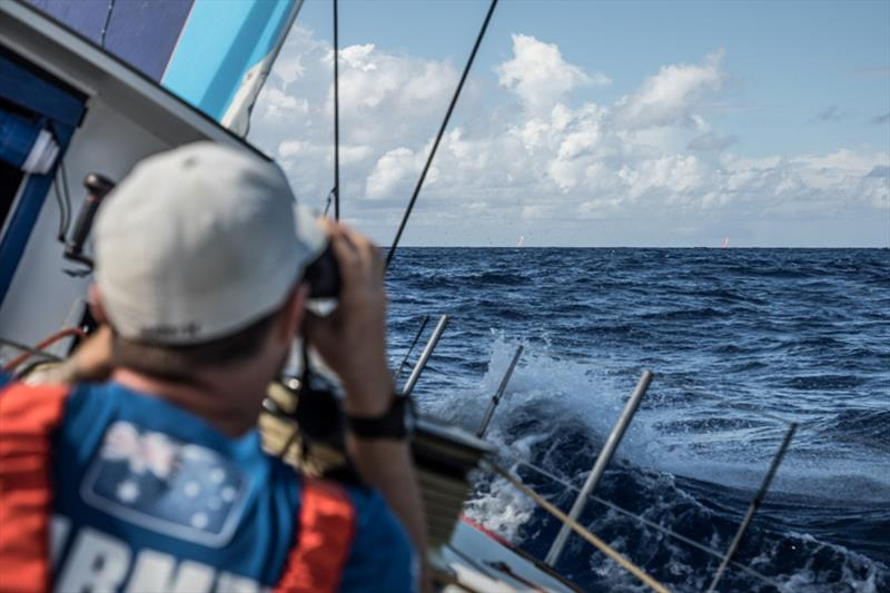 Volvo Ocean Race Leg 8 from Itajai to Newport, day 02 on board Vestas 11th Hour. Phil Harmer look at the red boats. - photo © Martin Keruzore / Volvo Ocean Race