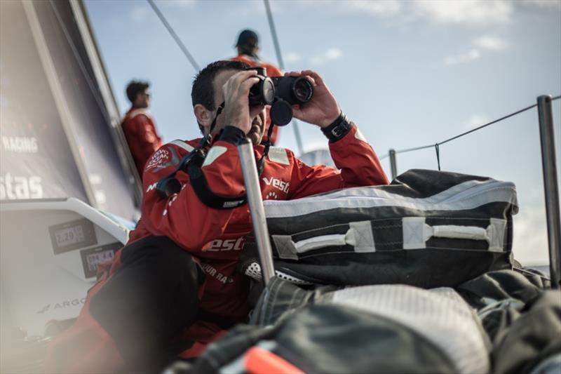 Volvo Ocean Race Leg 8 from Itajai to Newport, day 05, on board Vestas 11th Hour. Charlie Enright looks at the other red boat. - photo © Martin Keruzore / Volvo Ocean Race