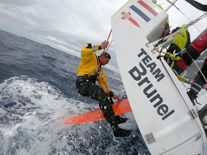 Volvo Ocean Race Leg 9, from Newport to Cardiff, day 3, on board Brunel. Kyle Langford sanding down rudder damage. - photo © Sam Greenfield / Volvo Ocean Race
