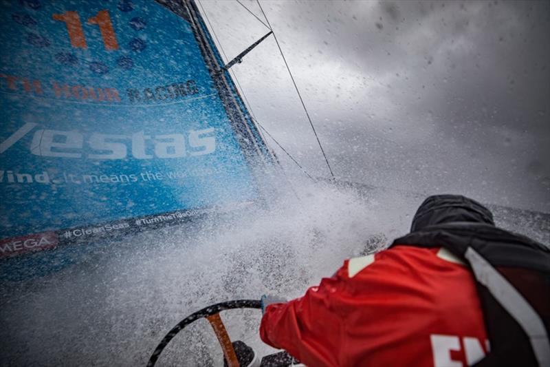 Volvo Ocean Race Leg 10, from Cardiff to Gothenburg, day 04, on board Vestas 11th Hour. Charlie protecting himself from the harsh splashes. - photo © Jeremie Lecaudey / Volvo Ocean Race