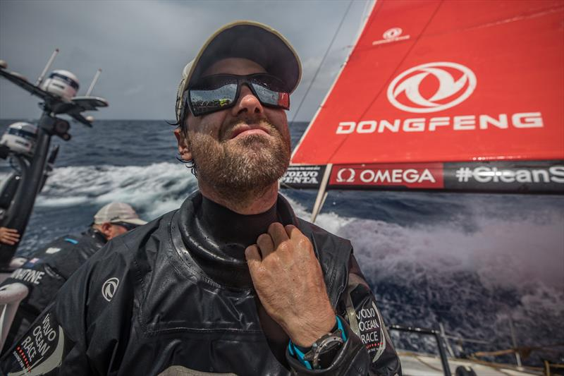 Leg 8 from Itajai to Newport, day 10 on board Dongfeng. 01 May, . Daryl Wislang opens his wet weather gear. - photo © Jeremie Lecaudey / Volvo Ocean Race