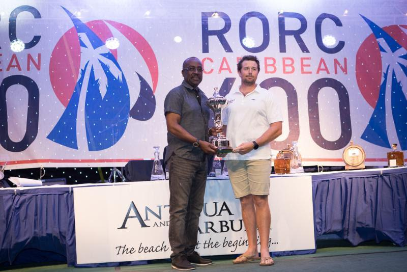 The Hon. E.P. Chet Greene, Ministry of Foreign Affairs, International Trade and Immigration presents the overall winners trophy to a member of David and Peter Askew's Volvo 70 Wizard - 2019 RORC Caribbean 600 - photo © Arthur Daniel