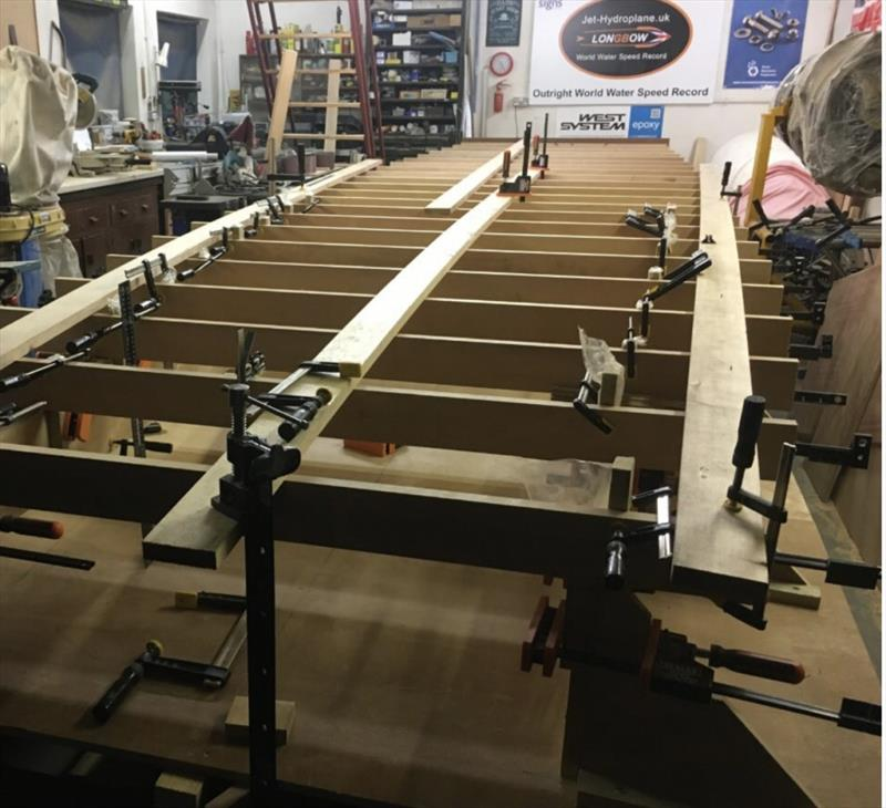 Supported by a metal frame, the first elements of the hydroplane's hull are being assembled (August 2018) photo copyright Wessex Resins & Adhesives taken at  and featuring the  class