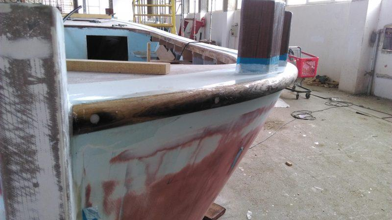 One of the two parallel mahogany rubbing strakes is attached - photo © Wessex Resins & Adhesives