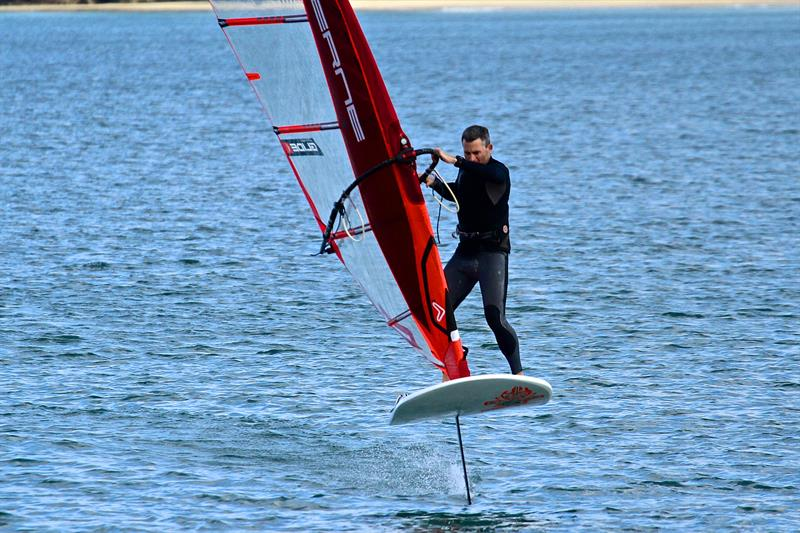 Olympic rep JP Tobin doing a foiling gybe in light winds  - Takapuna Beach - October 2018 - photo © Richard Gladwell