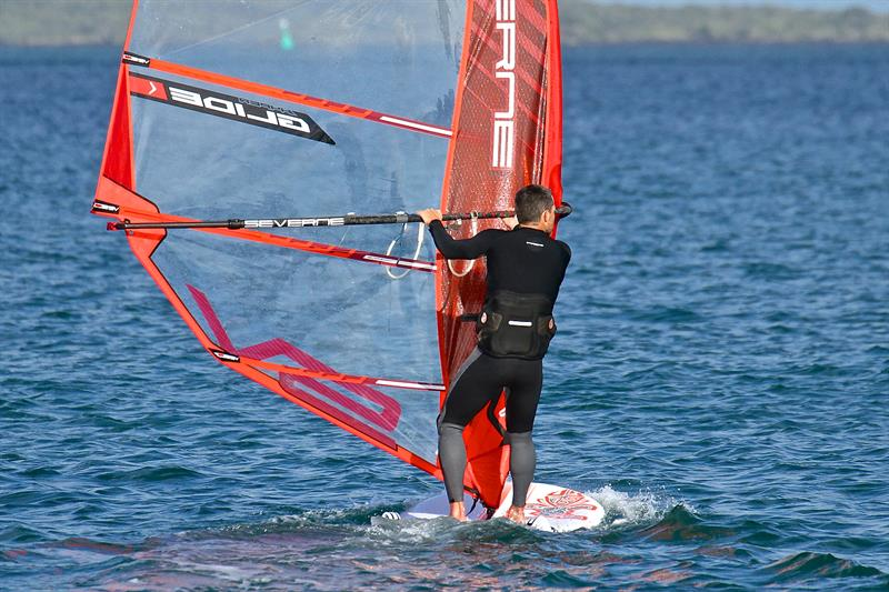 Windfoil at displacement speed - soon afterward the board was lifted onto the foil with a couple of quick arm pumps  - October 2018 - photo © Richard Gladwell
