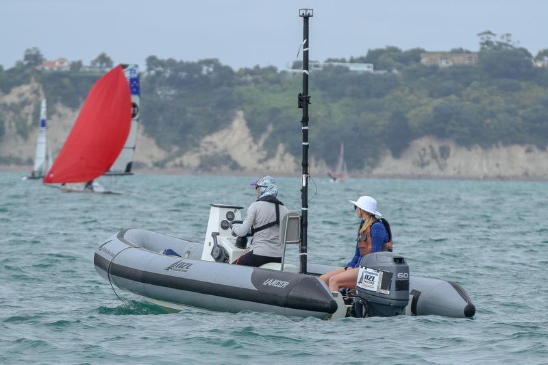 The lightweight kit for WindBot packs down into a a carry case and consists of the acoustic anemometer, with `The Brain`  or black box attached to the spar, which is secured to the coach boat. - photo © Richard Gladwell